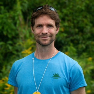 Headshot of Stuart smiling and wearing a blue Horizons t-shirt.