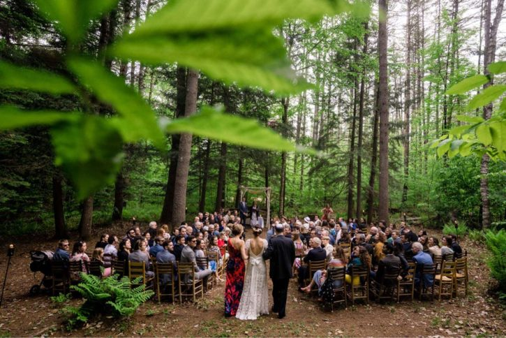A bride at the end of the aisle at an outdoor wedding.