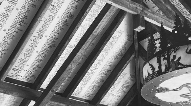 A black and white view of a ceiling with lists of handwritten names.