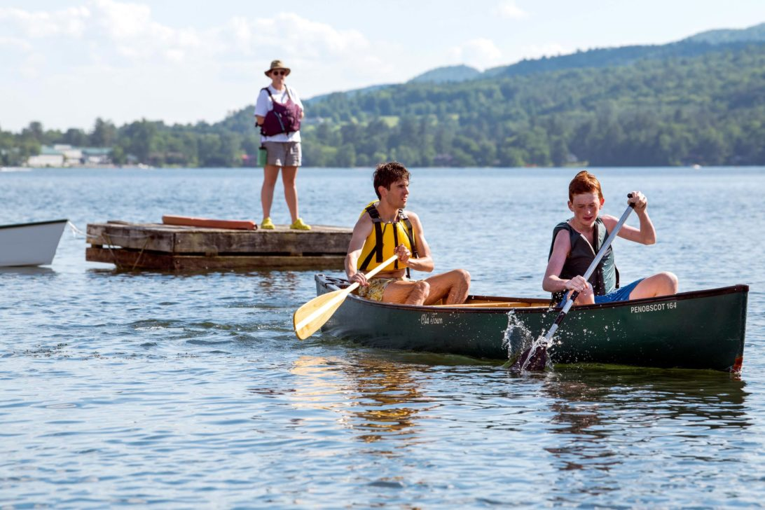 Campers canoeing on the lake.