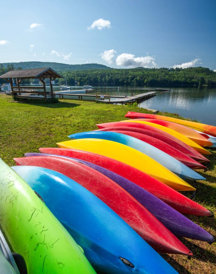 Colorful canoes lined up in a row.
