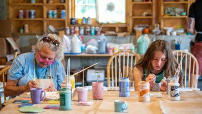 Ohana campers working on art.