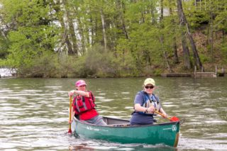 Two people canoeing.