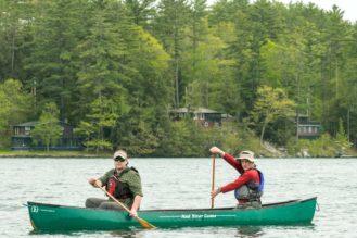 Two men canoeing.