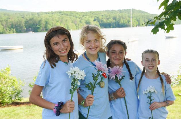 Four girls holding flowers.