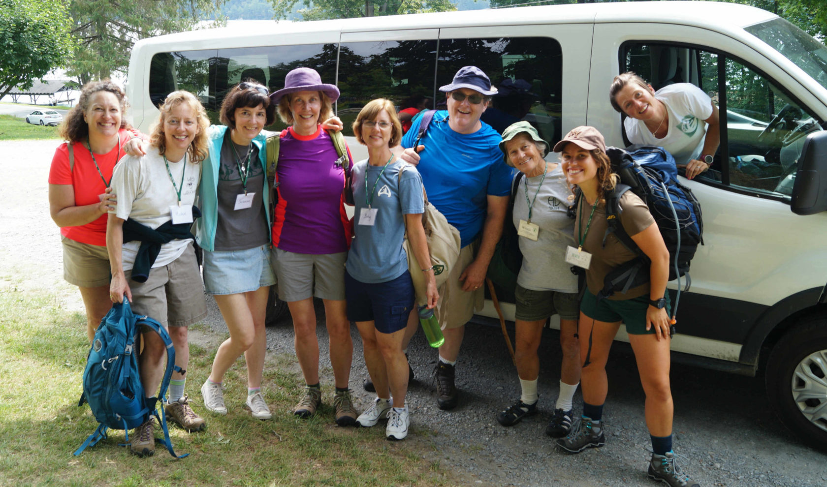 Campers standing outside a van.