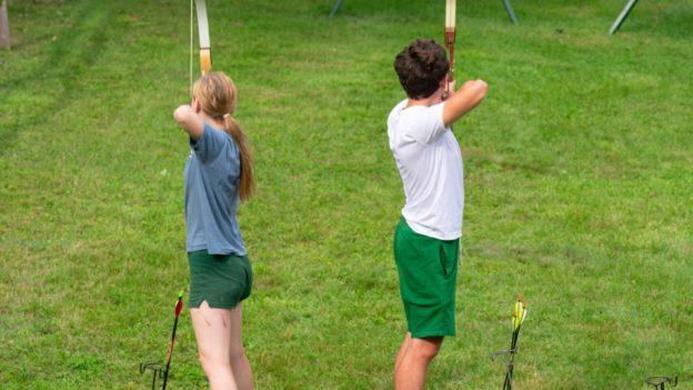 Campers shooting arrows.