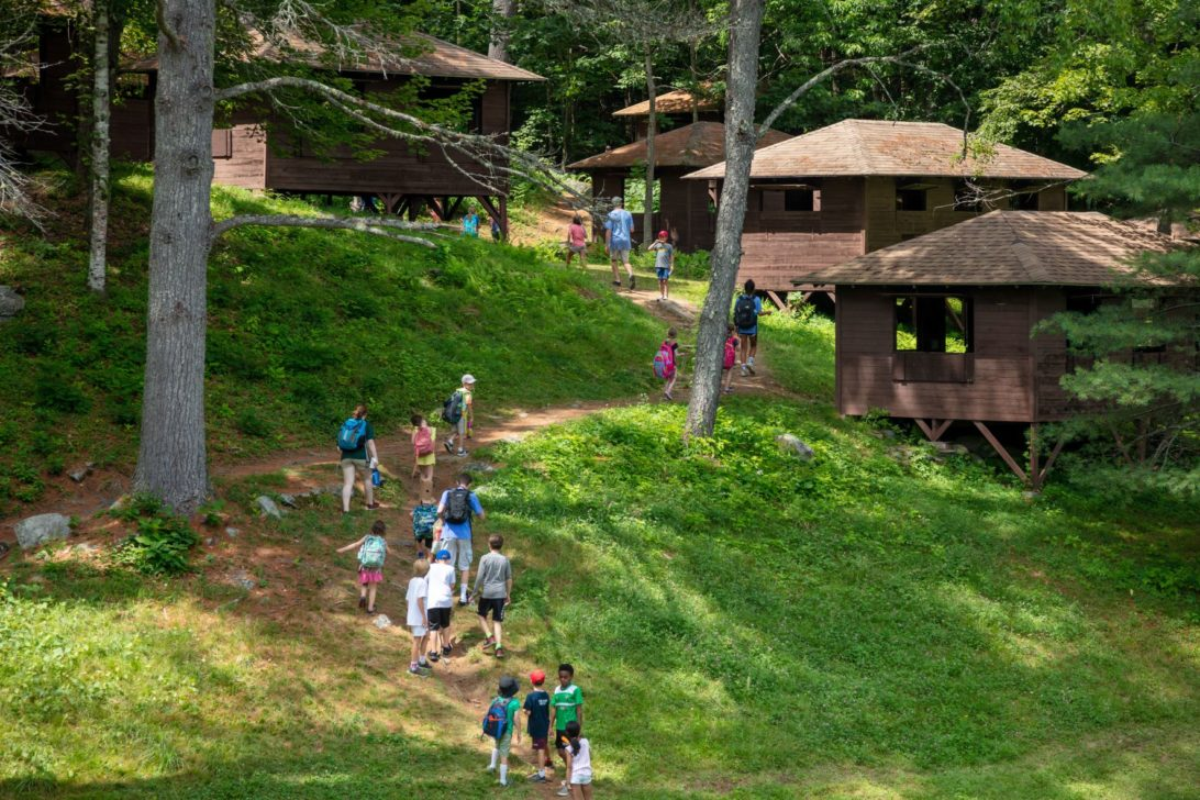 Campers walking up a hill.