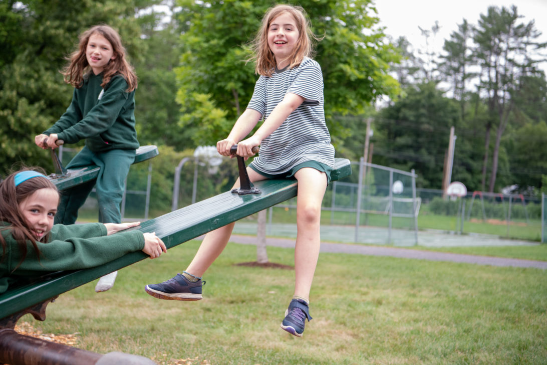 Campers riding seesaws.