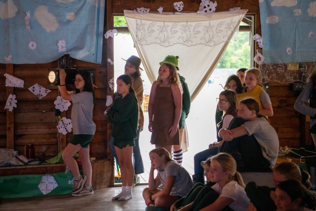 Campers performing in front of an audience.