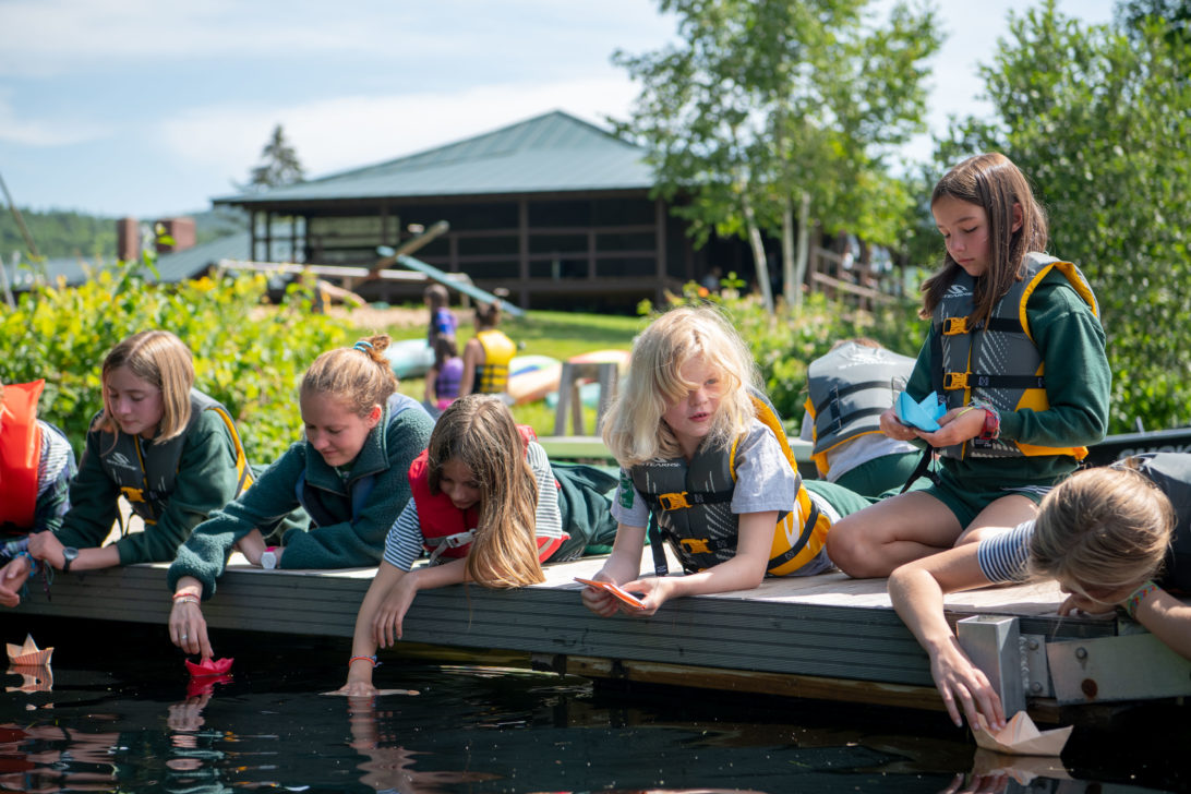 Campers on the dock in life jackets.