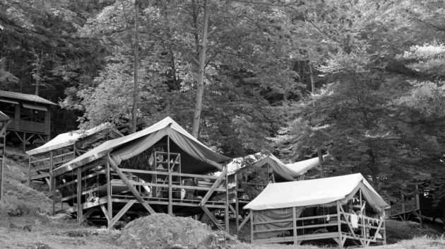 A black and white view of open air cabins.
