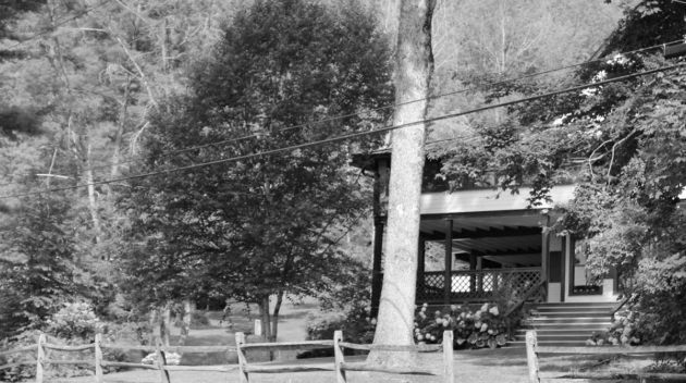 A black and white view of the outside of a house.
