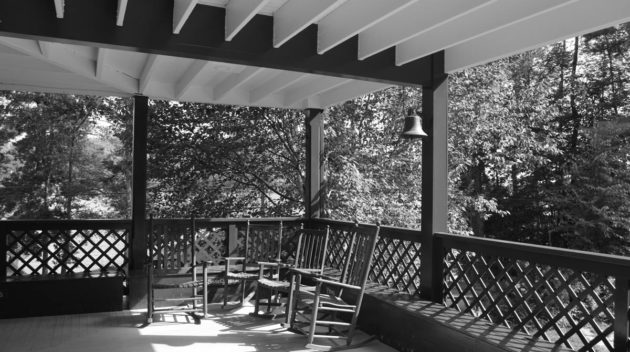 A black and white view of a porch.