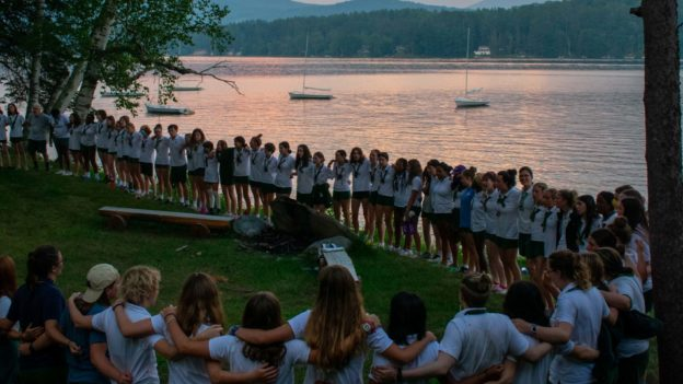 Campers standing in a circle.