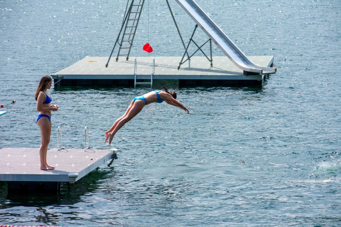 A camper diving into a lake.