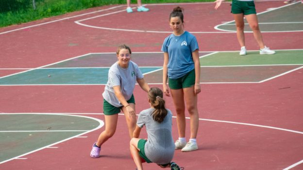 Campers playing sports on a court.