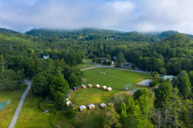 an aerial view of the camp cabins.