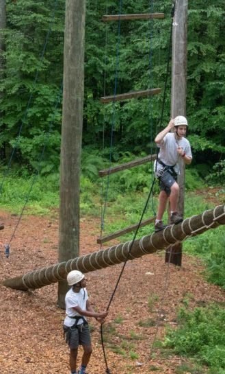 Campers doing a ropes course.