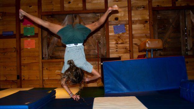 A camper learning gymnastics.