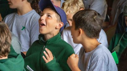 Campers singing during a camp assembly.