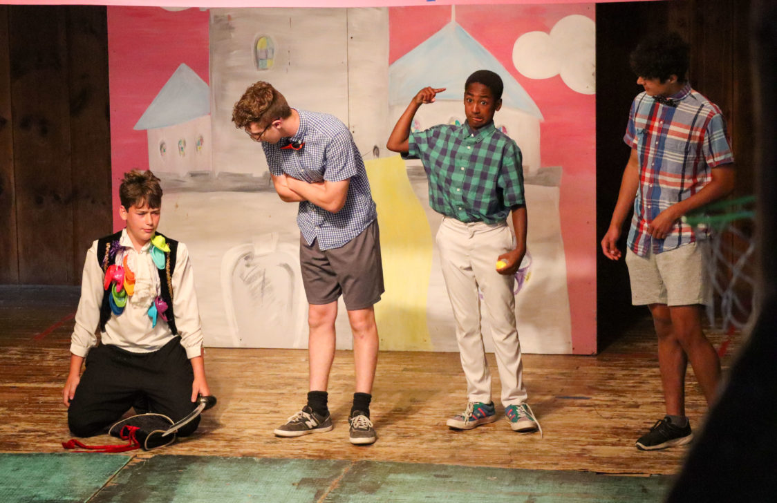 Four campers acting on stage.