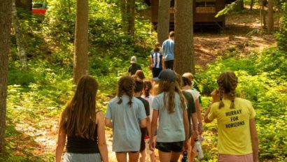 Campers walking on a trail.