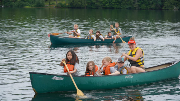 Campers learning how to canoe.