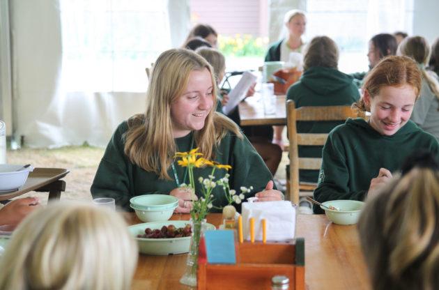 Campers eating together.