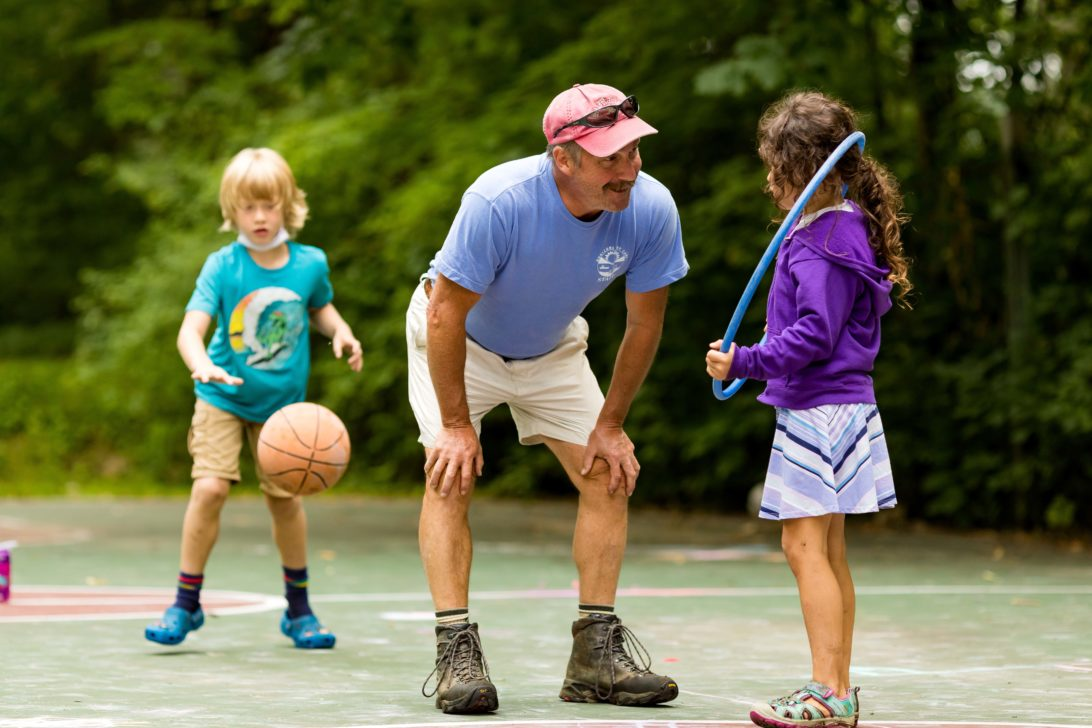 Campers playing on the basketball courts.