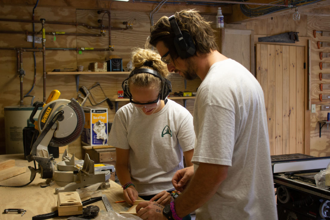 Two campers in a woodshop.
