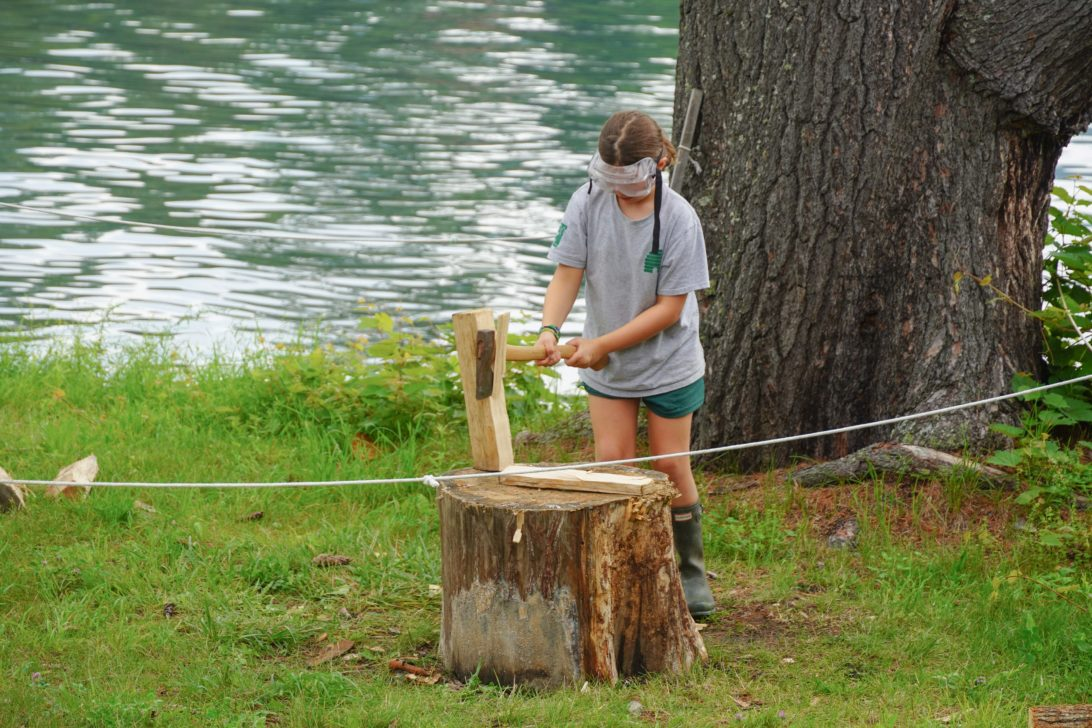 Campers learning how to chop wood.