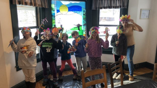 Campers posing with colorful masks.