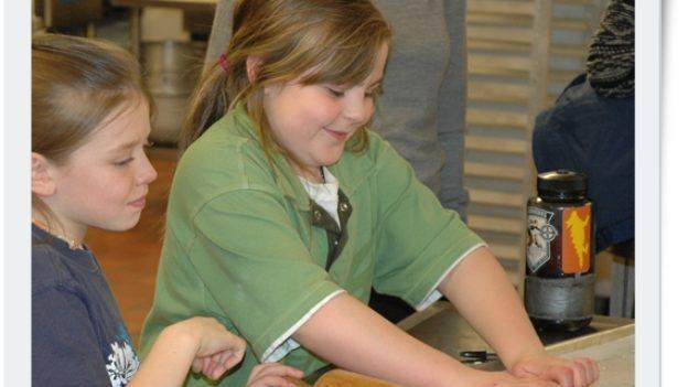 A girl kneading dough.