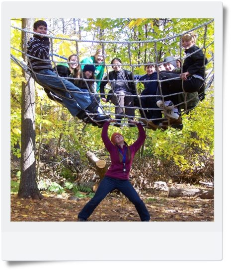 A group of Hulbert campers in a climbing net.