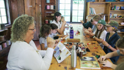 Campers working on arts and crafts.