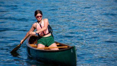 A camper canoeing.