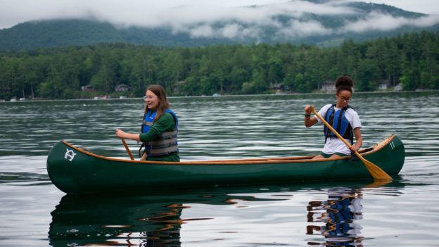 Two campers canoeing.