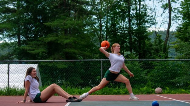 Two campers playing handball.