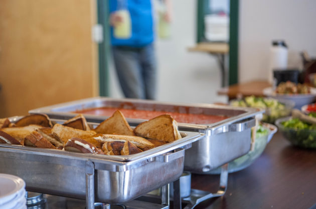 A buffet line with grilled cheese sandwiches.