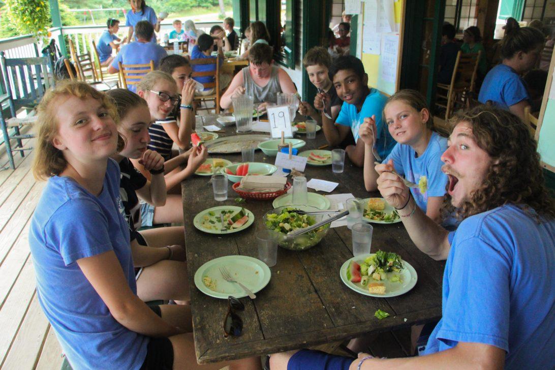 Campers having a meal together.