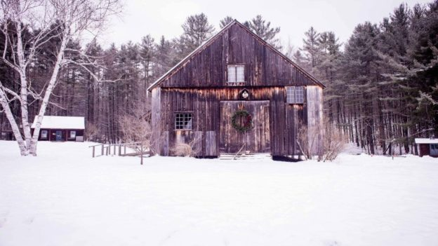 A barn during the winter.