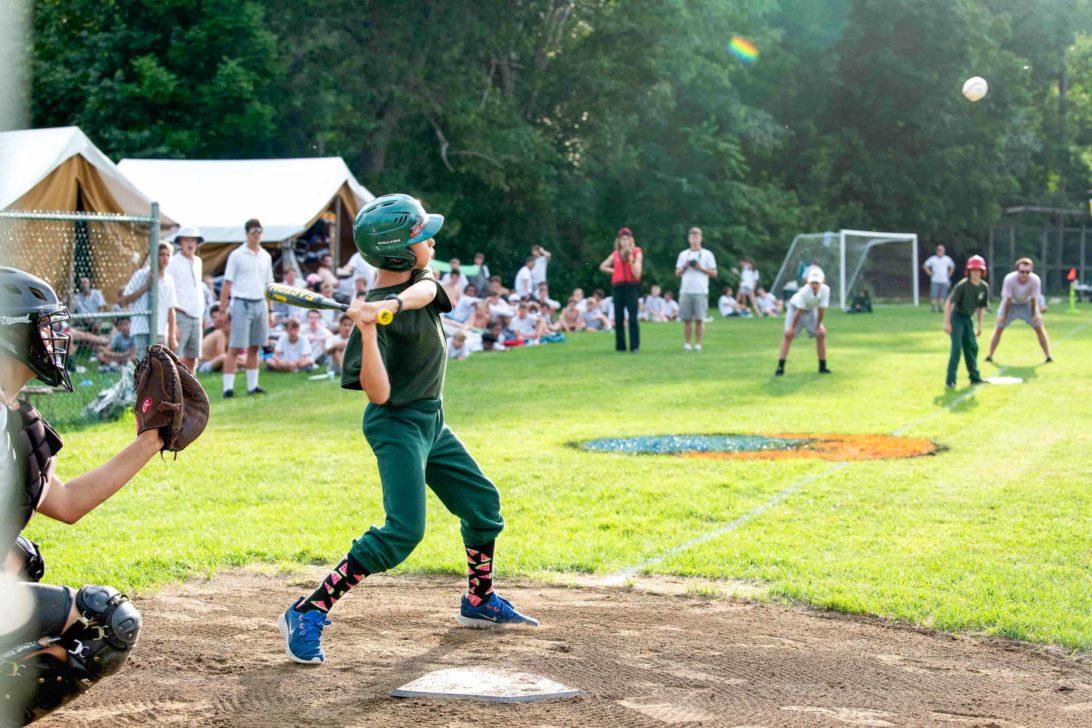 Campers playing baseball.