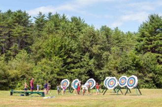 Campers learning archery.