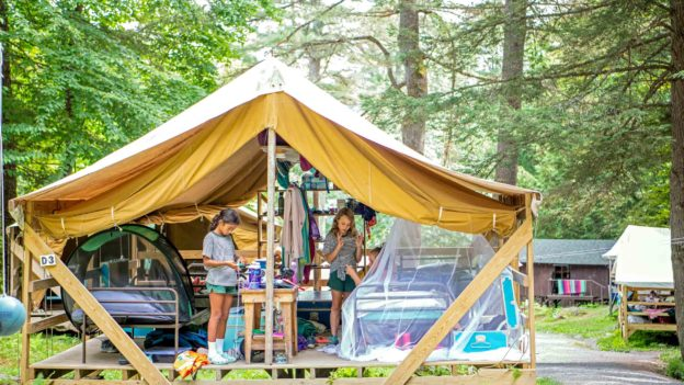 Campers in open air cabins.