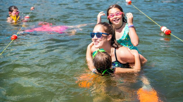 Campers swimming.